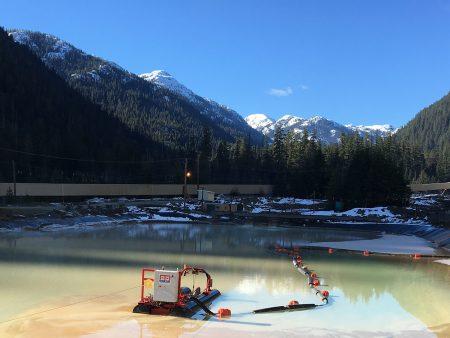 A MC 50E cleans a tailings dam in Canada.